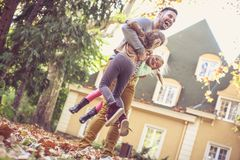 Father have play with children at backyard, On the move. royalty free stock photo