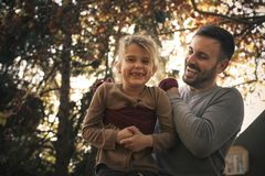 Father have play wit daughter , carrying her with scarf. Leisure activity stock image