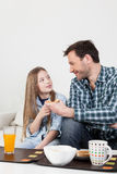 Father having a breakfast with his daughter Stock Photography