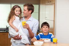 Father having breakfast with his kids Stock Photo