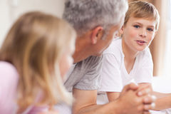 Father having a discussion with his children Stock Photography