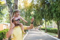 Father is having fun with his little daughter, a walk, summer ho Stock Photos