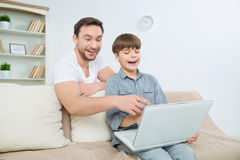 Father having hilarious time with son Stock Photography