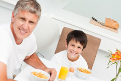 Father having his breakfast with his son Royalty Free Stock Images