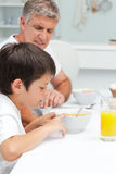Father having his breakfast with his son Royalty Free Stock Photos