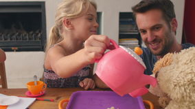 Father Having Tea Party With Children And Toys In Bedroom. Father sitting in bedroom with children and toys having tea party.Shot on GH4 at frame rate of 25fps stock footage