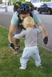 Father hedging their baby, toddler learning to walk. Father hedging baby, toddler learning to walk royalty free stock photo