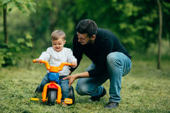 Father help his child to ride Stock Photography