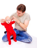 Father helping baby Stock Images
