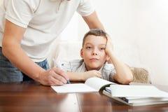 Father helping child do homework stock photos