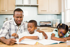 Father helping children for homework Royalty Free Stock Photo