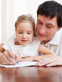 Father helping daughter Royalty Free Stock Image