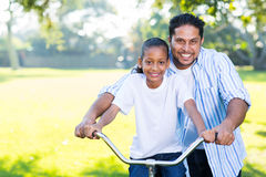 Father helping daughter bike Royalty Free Stock Photography