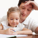 Father helping daughter do mathematics royalty free stock photo