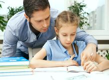 Father helping daughter. Stock Image