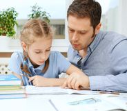 Father helping daughter. Royalty Free Stock Image