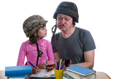 Father helping daughter with a homework assignment Stock Photo
