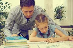Father helping daughter with homework. Royalty Free Stock Photography