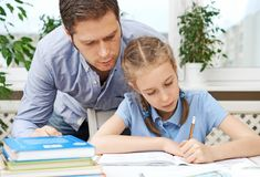 Father helping daughter with homework. Stock Image