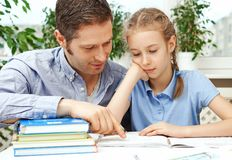 Father helping daughter with homework. Stock Photography