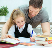 Father helping daughter. Royalty Free Stock Photo