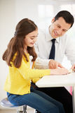 Father Helping Daughter With Homework Stock Photography
