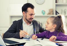 Father helping daughter with homework Royalty Free Stock Photos