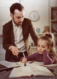Father helping daughter with homework Royalty Free Stock Images