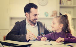 Father helping daughter with homework Royalty Free Stock Image