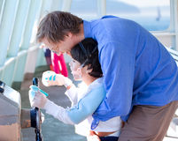 Father helping disabled son play with the ferry's steering wheel Royalty Free Stock Image