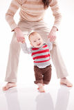 Father is helping her son to make first steps Royalty Free Stock Photography