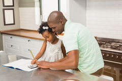 Father helping his daughter with homework Royalty Free Stock Photos