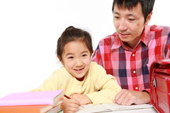 Father helping his daugther doing homework Stock Photos