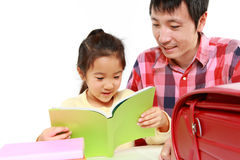 Father helping his daugther doing homework Royalty Free Stock Image