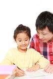 Father helping his daugther doing homework Royalty Free Stock Photos
