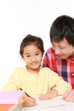 Father helping his daugther doing homework Royalty Free Stock Images