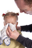 Father helping his little gril to blow her nose Stock Photography