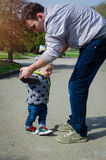 Father helping his son for the first steps Royalty Free Stock Image