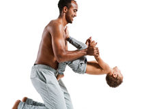 Father helping his son with his fitness exercises. Photo set of sporty muscular Hispanic shirtless fitness men with his son over white background royalty free stock images