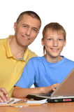 Father is helping his son Stock Photos