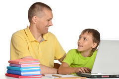 Father is helping his son Royalty Free Stock Image