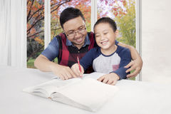 Father is helping his son to learn Stock Photo