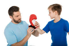 Father helping his son to put on boxer gloves isolated on white Royalty Free Stock Photos