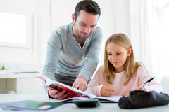 Father helping out her daughter for homework Royalty Free Stock Photo