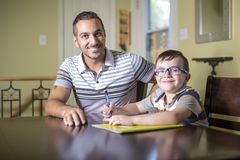 Father helping son do homework. Parent helps his child Stock Photography