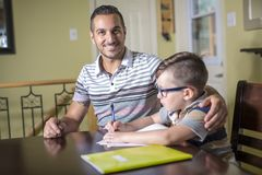 Father helping son do homework. Parent helps his child Royalty Free Stock Photography