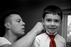 Father Helping Son Get Ready Royalty Free Stock Photos