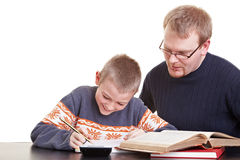 Father helping son with his Royalty Free Stock Photos