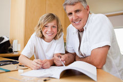Father helping son with his homework Stock Images