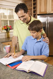 Father Helping Son with Homework Royalty Free Stock Photos